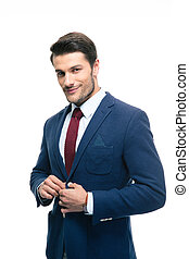 Happy handsome businessman putting on suit jacket isolated...