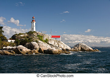 Lighthouse - A heritage lighthouse stands guard on a rocky...