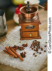 Ingredients for Turkish coffee - Wooden coffee grinder and...