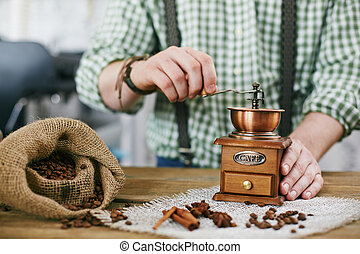Tampering coffee beans - Barista tampering coffee beans in...
