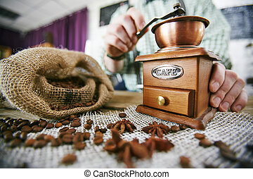 Working with coffee grinder - Barista tampering coffee beans...