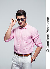 Portrait of a young handsome man in sunglasses