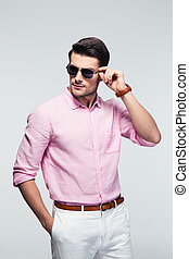 Portrait of a trendy young man in sunglasses