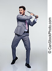 Angry businessman trying to smash his laptop - Full length...