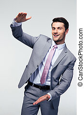 Businessman bragging about the size of something