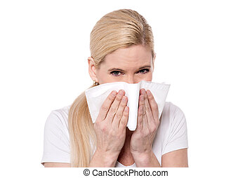 OMG, i got cold - Sick woman blowing her nose into a tissue