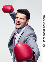 Angry businessman with boxing gloves