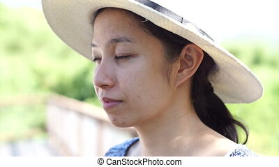 Asian woman with hat - Asian woman enjoy herself in hot...