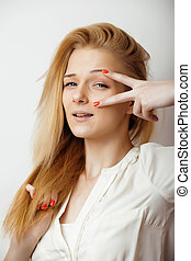 teenage cute blond girl thinking, frustrated, emotional on...