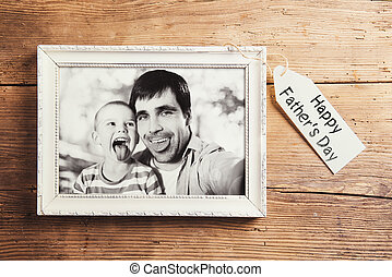 Fathers day composition - picture frame with a black and...