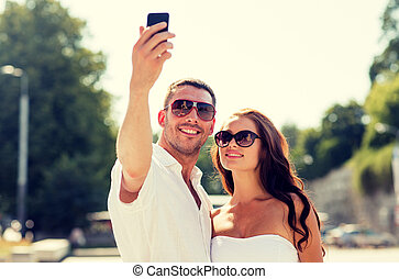 smiling couple in city - love, wedding, summer, dating and...