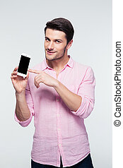 Businessman pointing finger on smartphone screen - Happy...