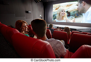 happy couple watching movie and talking in theater - cinema,...