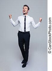 Happy businessman celebrating his success - Full length...