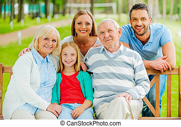Happy family. Happy family of five people bonding to each...