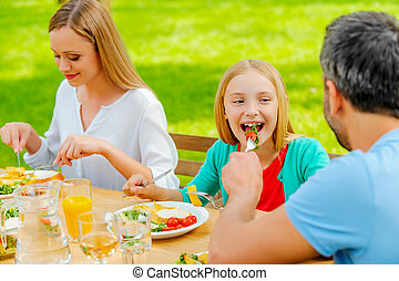 Sharing food with the nearest. Young man feeding his...