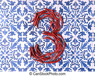 Spicy three on a tiled surface - 3D rendering of number...