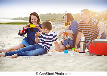 Family of five doing selfy at the picnic on the beach