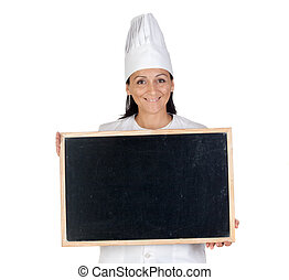 Pretty cook girl with blank slate isolated on white...
