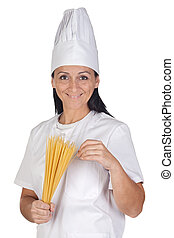 Pretty cook girl with long spaghetti isolated on white...