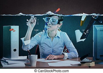 drowning in job - symbolic picture of a stressed female...