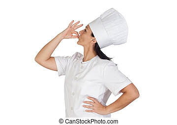 Pretty cook girl saying delicious - Pretty cook girl with...