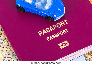 Passport with Toy Car - Close up detailed view of a passport...
