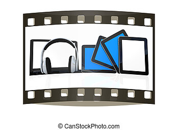 headphones on the laptop and tablet pc. The film strip -...