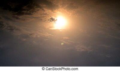 Beautiful setting sun behind clouds