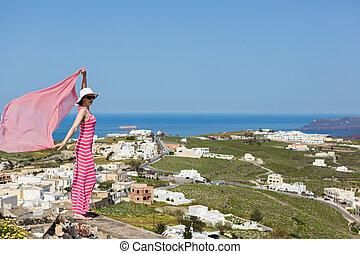 Woman in a long dress, Santorini, Greece. - Woman in a long...