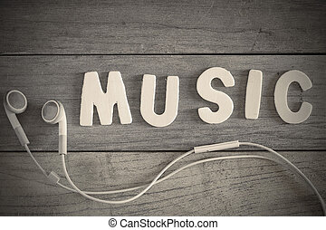 Music - Word music written with wood letters over a wooden...