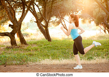 Woman Jogging - Young Woman Jogging in a Park at Sunset