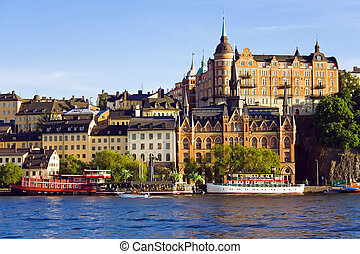 City skyline on blue sky - Stockholm city buildings on water