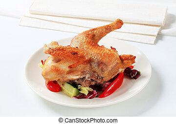 Roast chicken with vegetable garnish