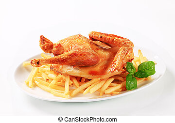 Crispy roast chicken with French fries - Crispy skin roast...