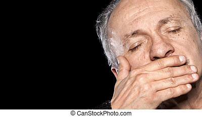 elderly man - An elderly man with closed eyes closes and...