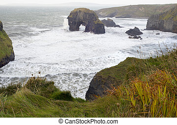 sepia virgin rocks and cliffs with storm waves - beautiful...