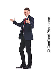 young handsome business man presenting - Full body picture...