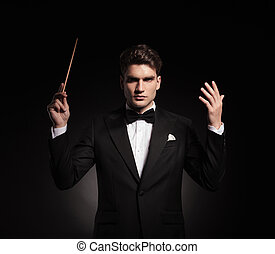 elegant man conducting an orchestra
