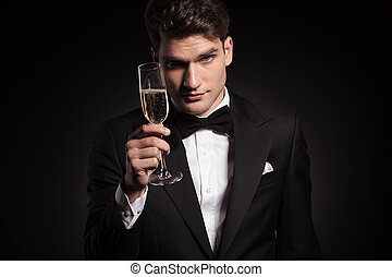 man offering you a glass of champagne. - Handsome elegant...