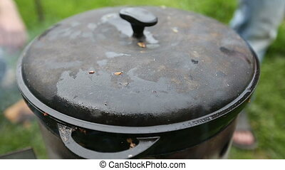 Cooking pilaf in a cauldron on the nature Delicious pilaf