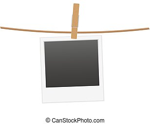 retro photo frame hanging on a rope