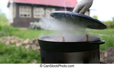 Cooking pilaf in a cauldron on the nature. Delicious pilaf