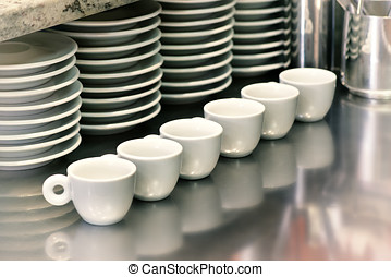 Small coffee cups on a metal cafeteria counter - Small...