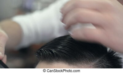 Having Hair Cut - Close up of cropped unrecognizable stylist...