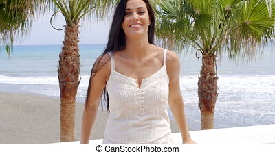 Woman in White Dress Standing on Tropical Beach - Waist Up...