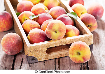 fresh peaches in wooden box
