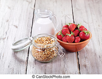breakfast with cereals, milk and strawberries