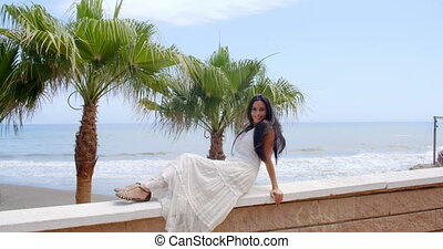 Young Lady Relaxing on Balcony Rails at the Beach - Young...
