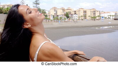 Woman Leaning Against Railings Viewing the Sea - Smiling...